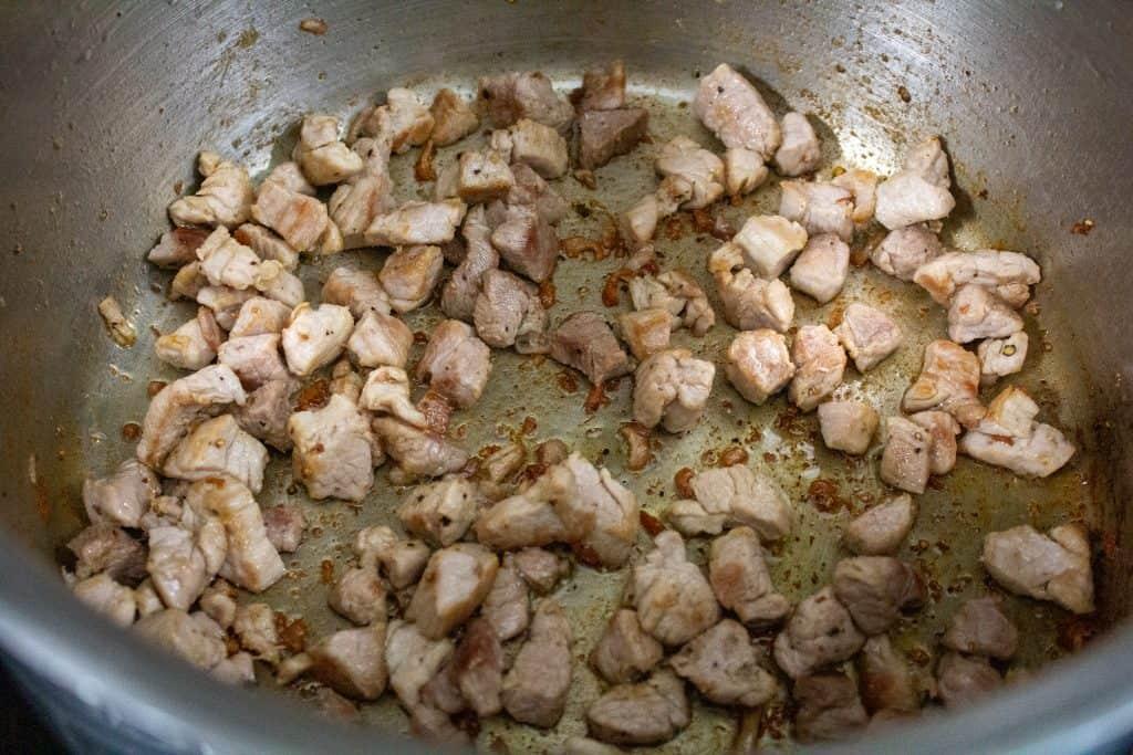 browned diced pork in large pot