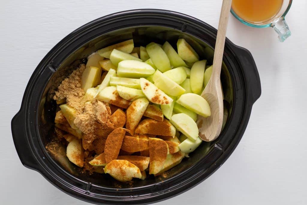 apples and spices in a slow cooker