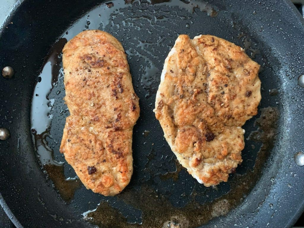 cooked chicken in a saute pan