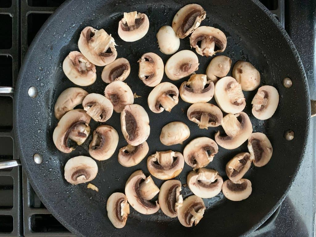 sliced mushrooms in a saute pan