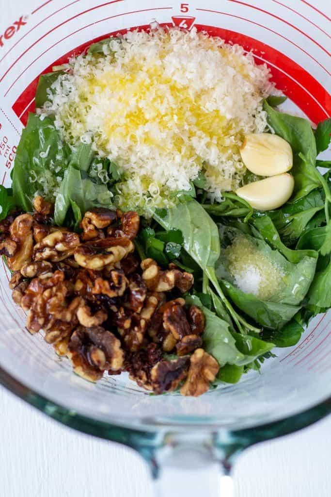 walnuts, cheese, garlic, basil, salt, olive oil in a bowl