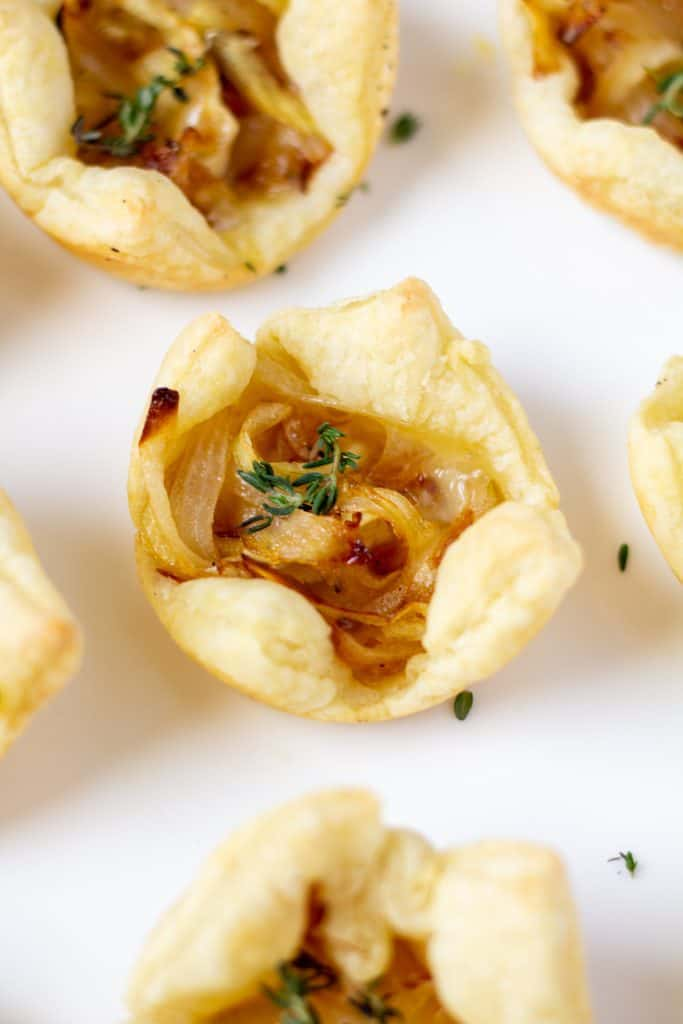 puff pasty appetizer bites on a white plate