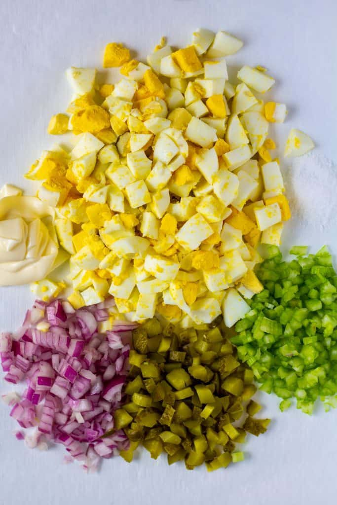 deconstructed egg salad on a white background